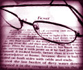 reading glasses on book page