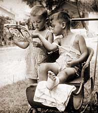 childhood image of Jim Trelease reading comic to injured friend