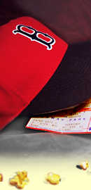 part of image of baseball bat, ball, popcorn, game tickets, and Red Sox hat